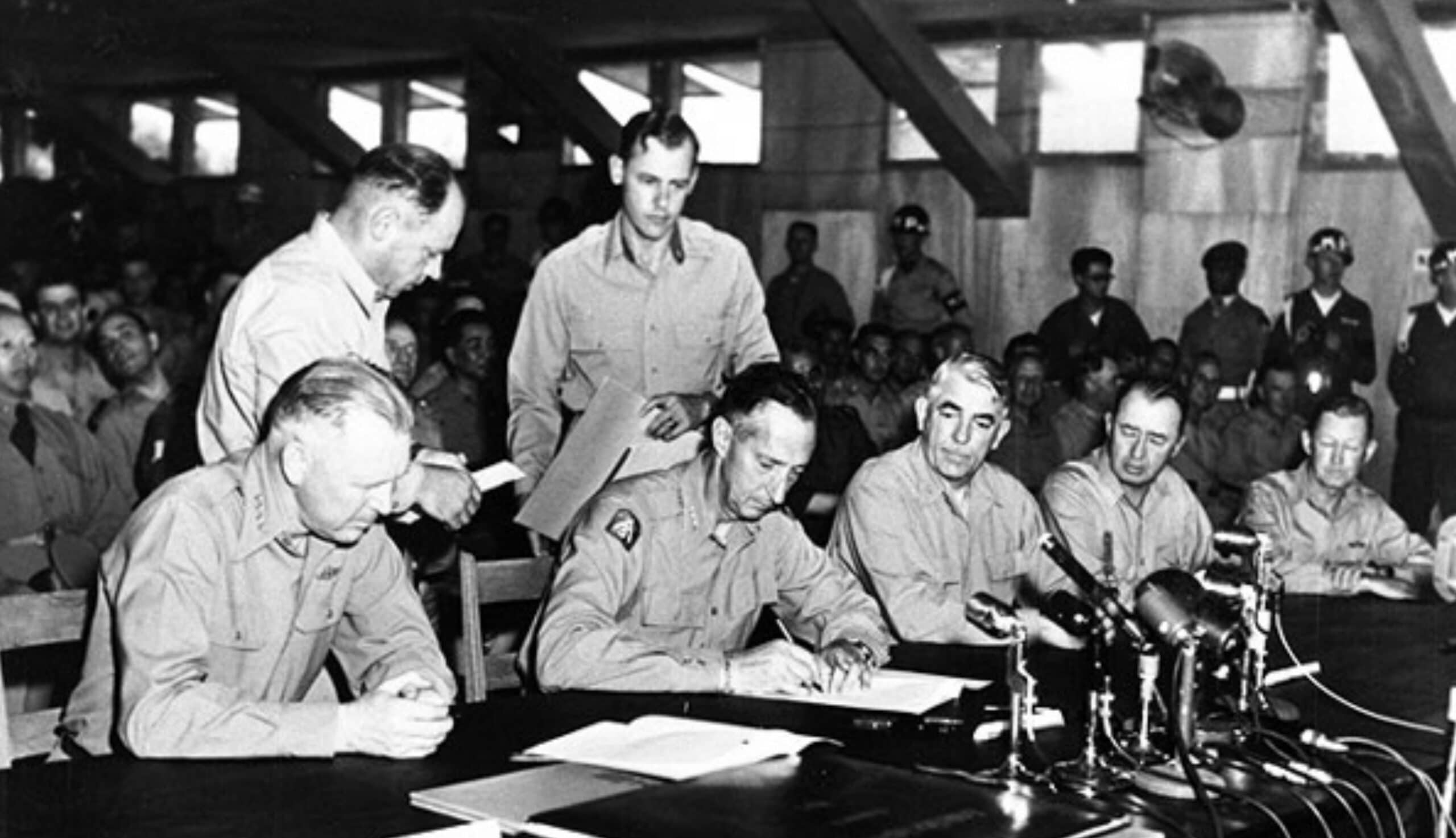 General Clark signs the Korean Armistice Agreement