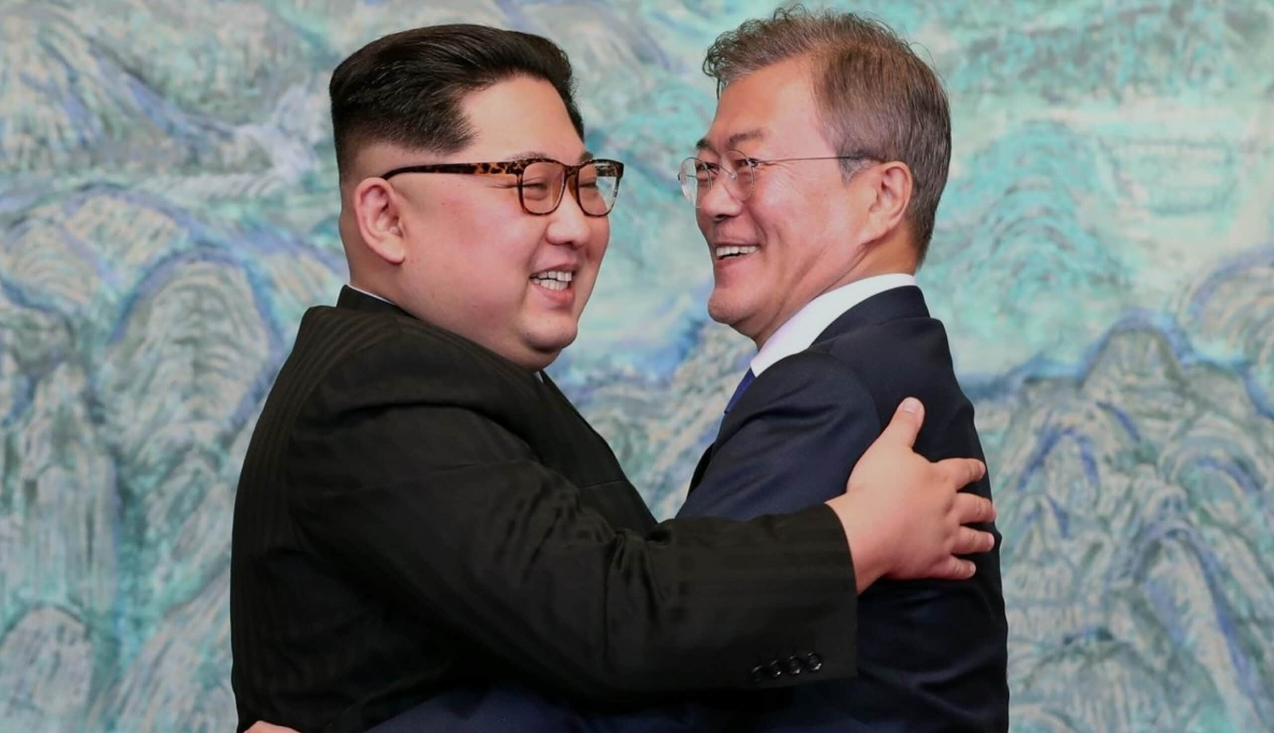 Moon Jae and Kim Jong-un hug