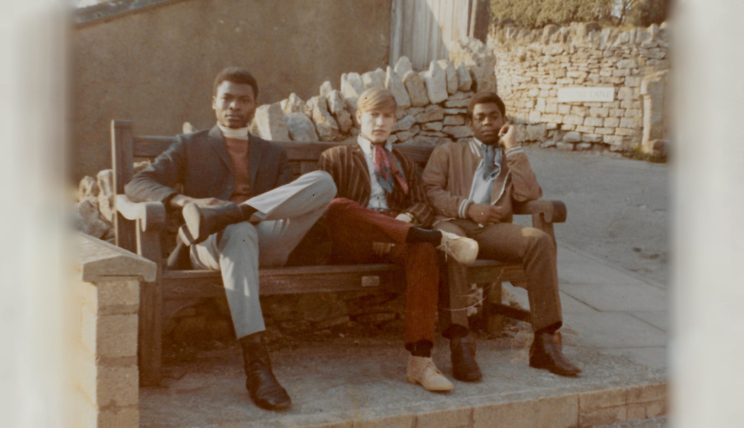 Three Young Men on a Bench by Dan Guthrie